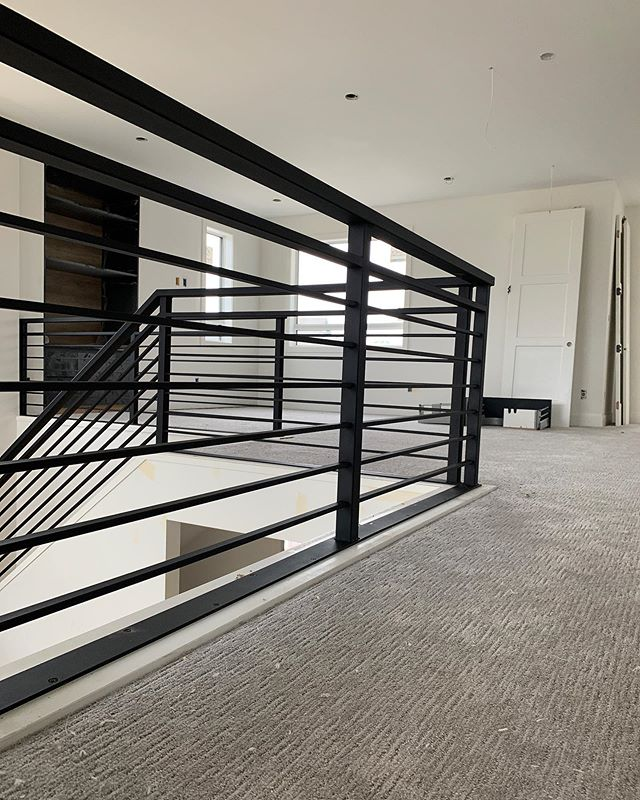 Horizontal lines from this recent railing project with @urban_edge_homes.  #yeg #yeghomes #yeginteriors #interiors #railings #interiordesign #design #flatblack
