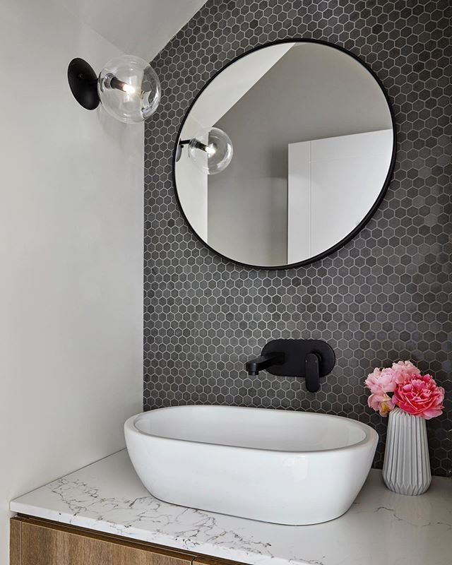 A tiled mosaic can create a beautiful accompaniment to contemporary joinery and tapware selections by adding interest and texture. With an array of formats, sizes and colours to choose from the options are endless #mosaictile #bluestone #elegancetiles #newhomebuild #powderroom #vanitydesign #colourselection #interiordesign