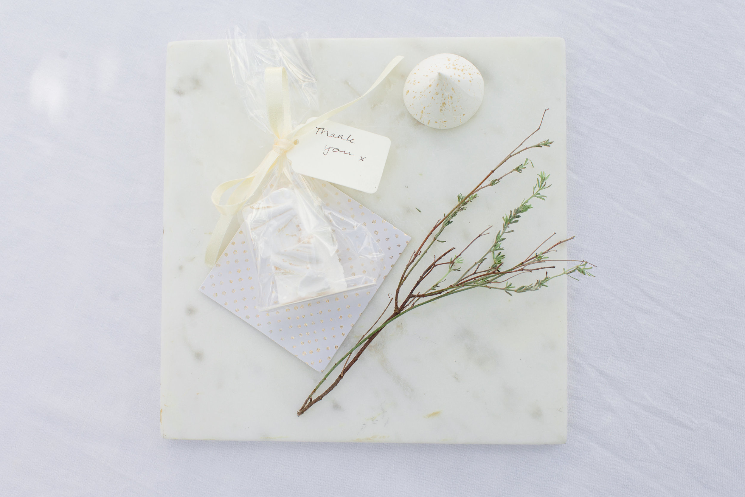 Subtle gold and white wedding favours.