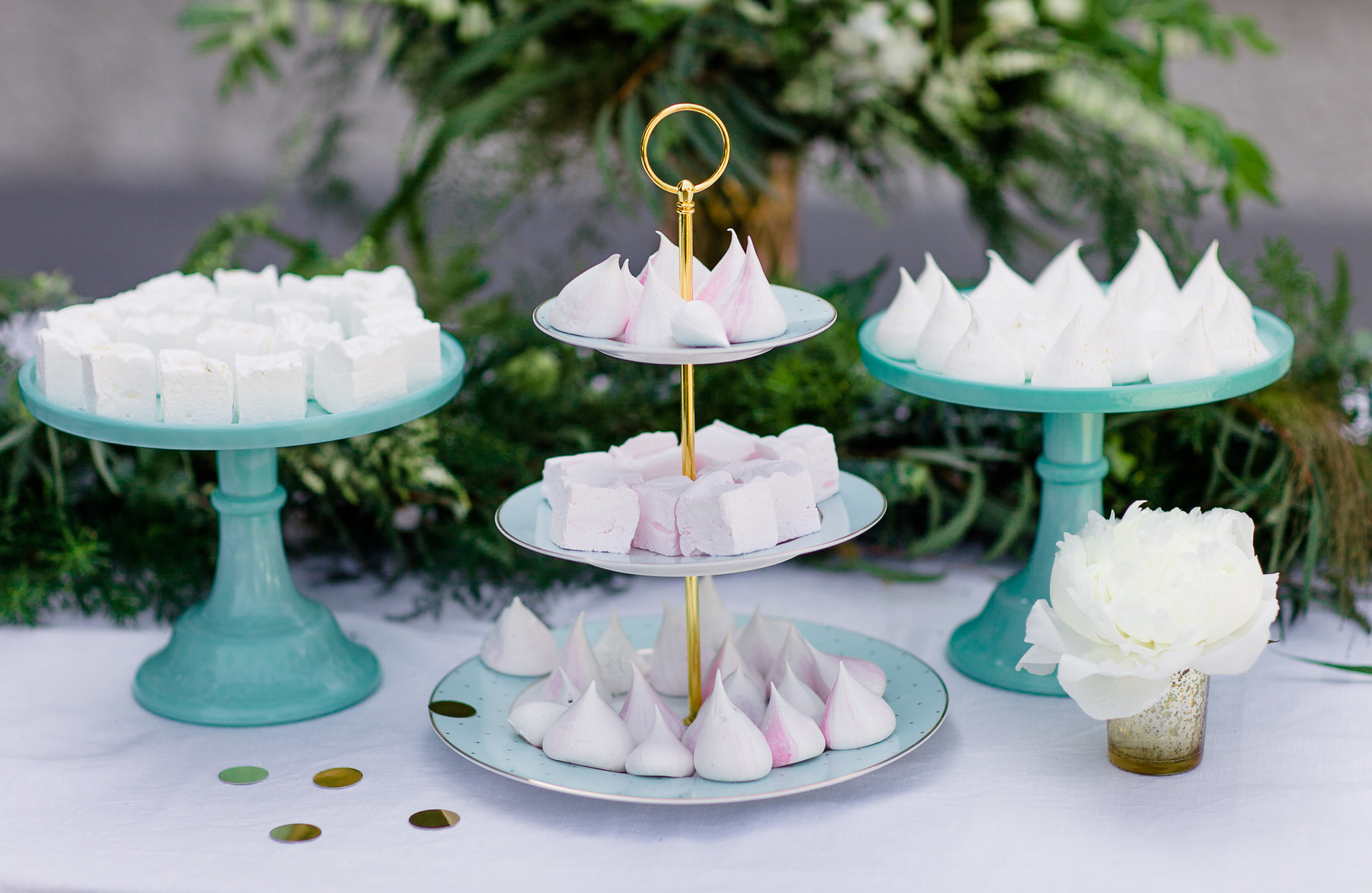 An array of blush, white and gold marshmallows and meringues, ideal for a champagne reception or dessert table.