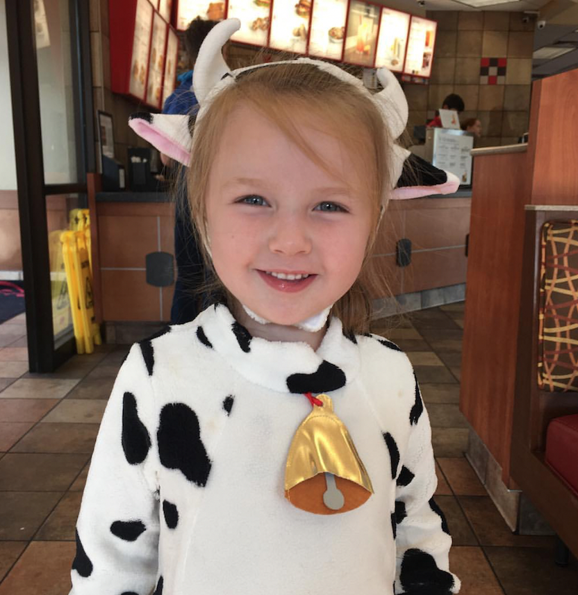 Little girl wearing cow costume