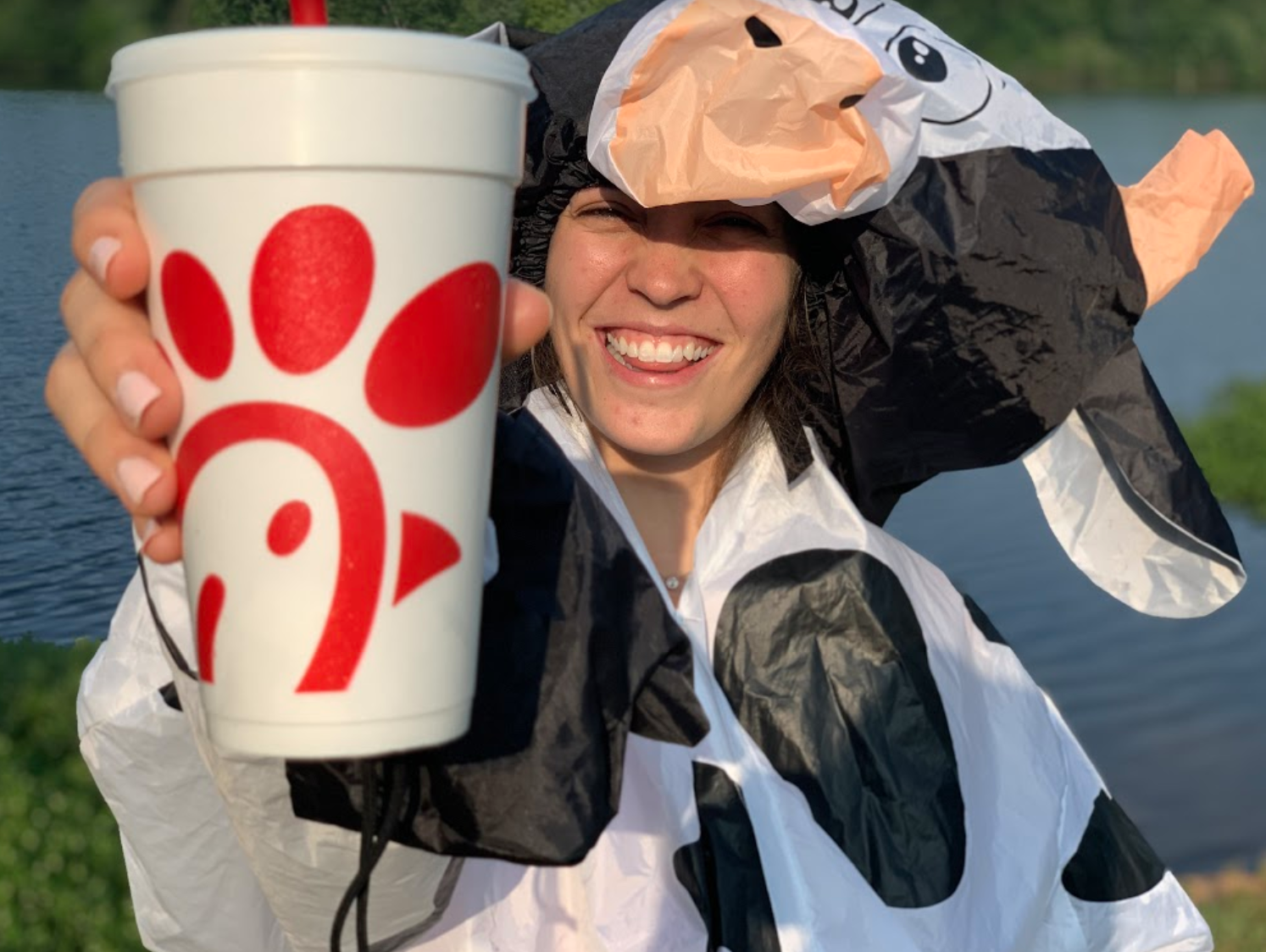 Woman dressed in cow-suit with Chik-fil-A cup