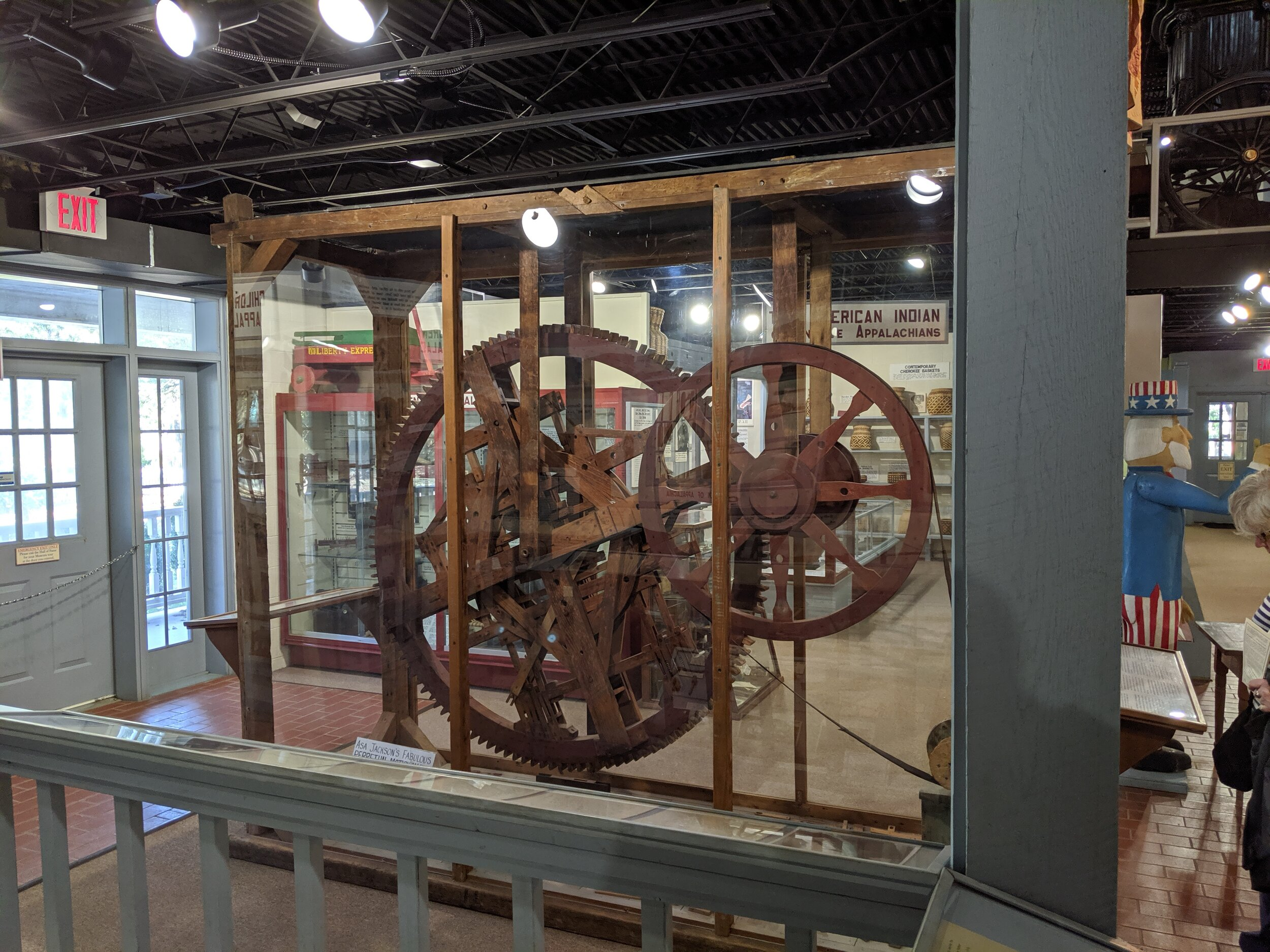 This is a perpetual motion machine, built in the 1800's. The inventor insisted on removing a few parts so others couldn't steal his idea. Unfortunately, he left it that way, and no one can figure out how to fix it.