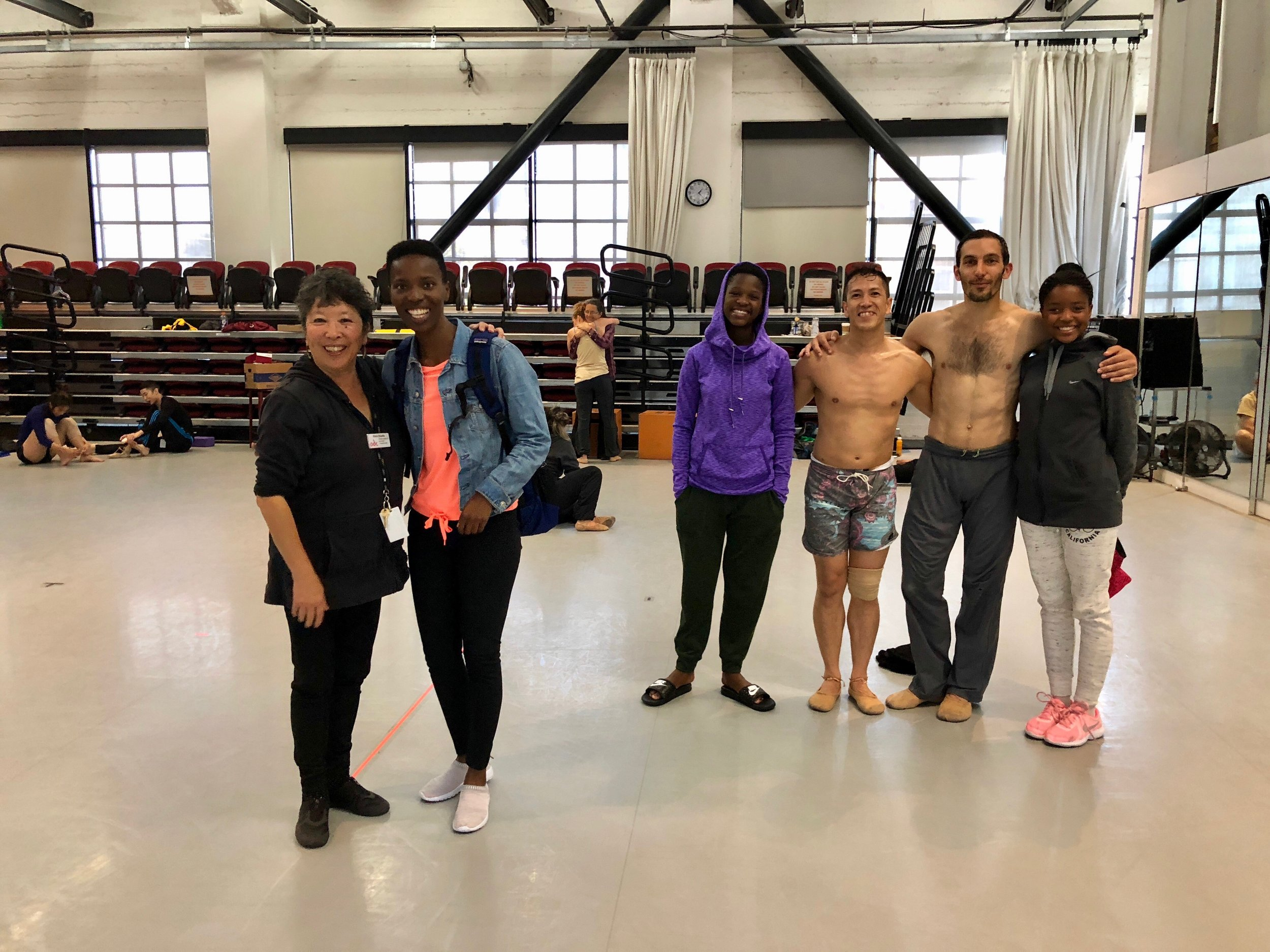 Olwethu with ODC School Director Kimi Okada and ODC company dancers after a rehearsal.