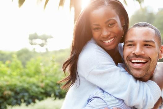 playful black couple smiles