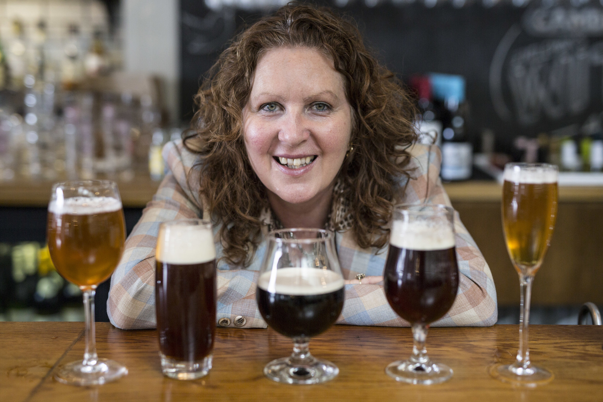 Jane Peyton with array of beers high res.jpg