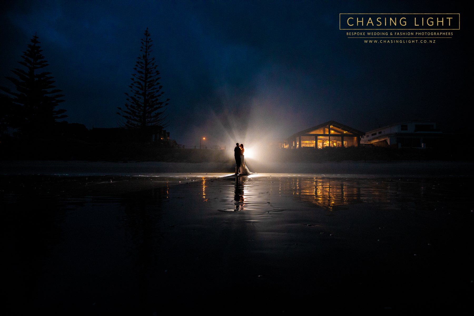 Nikki + Stuart outside Flat White Wedding Venue, Waihi Beach. © Chasing Light 2019.