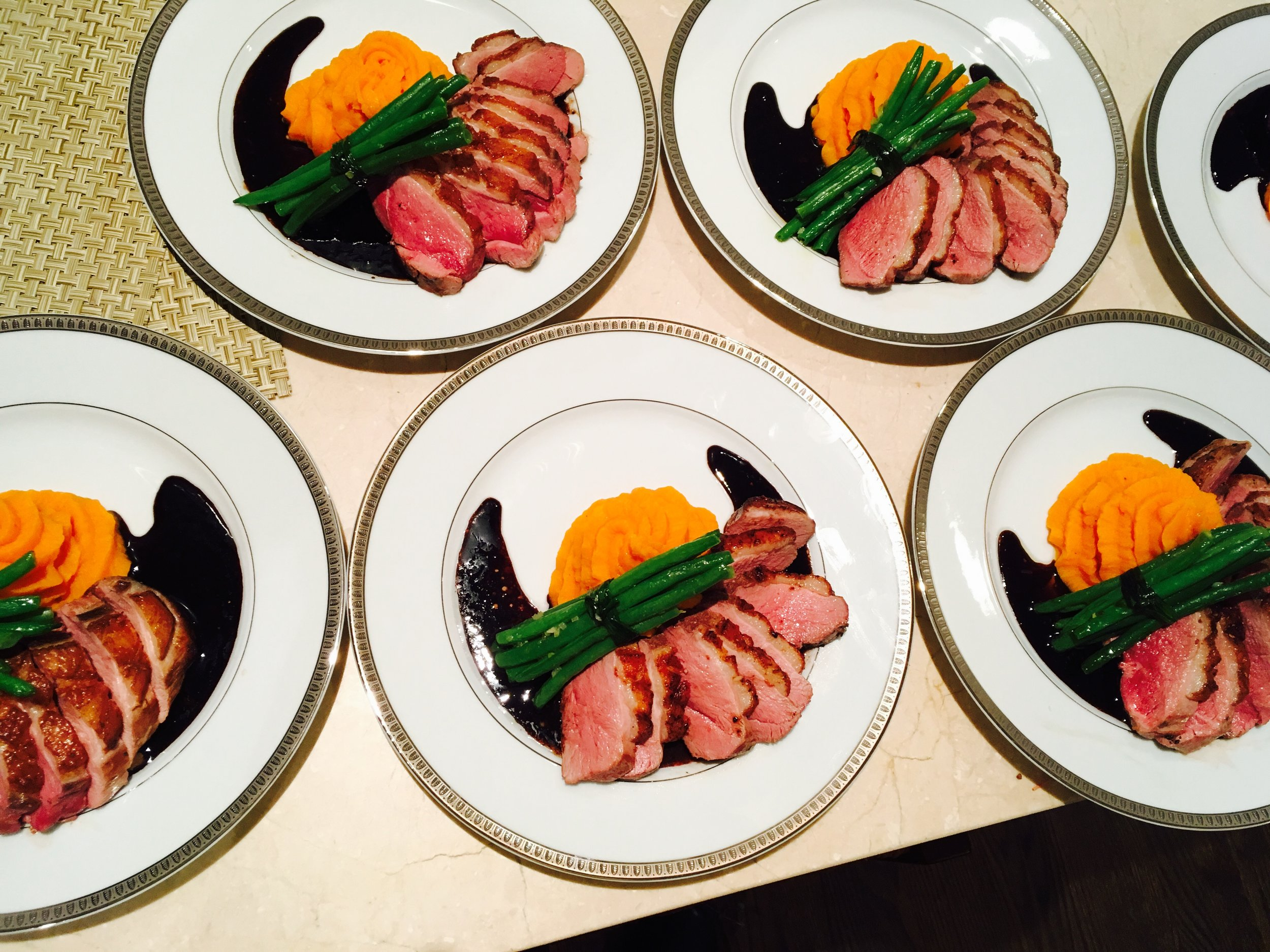 Pan Roasted Duck Breast with Sweet Potato Purée, Haricots Verts, and a Cassis Reduction