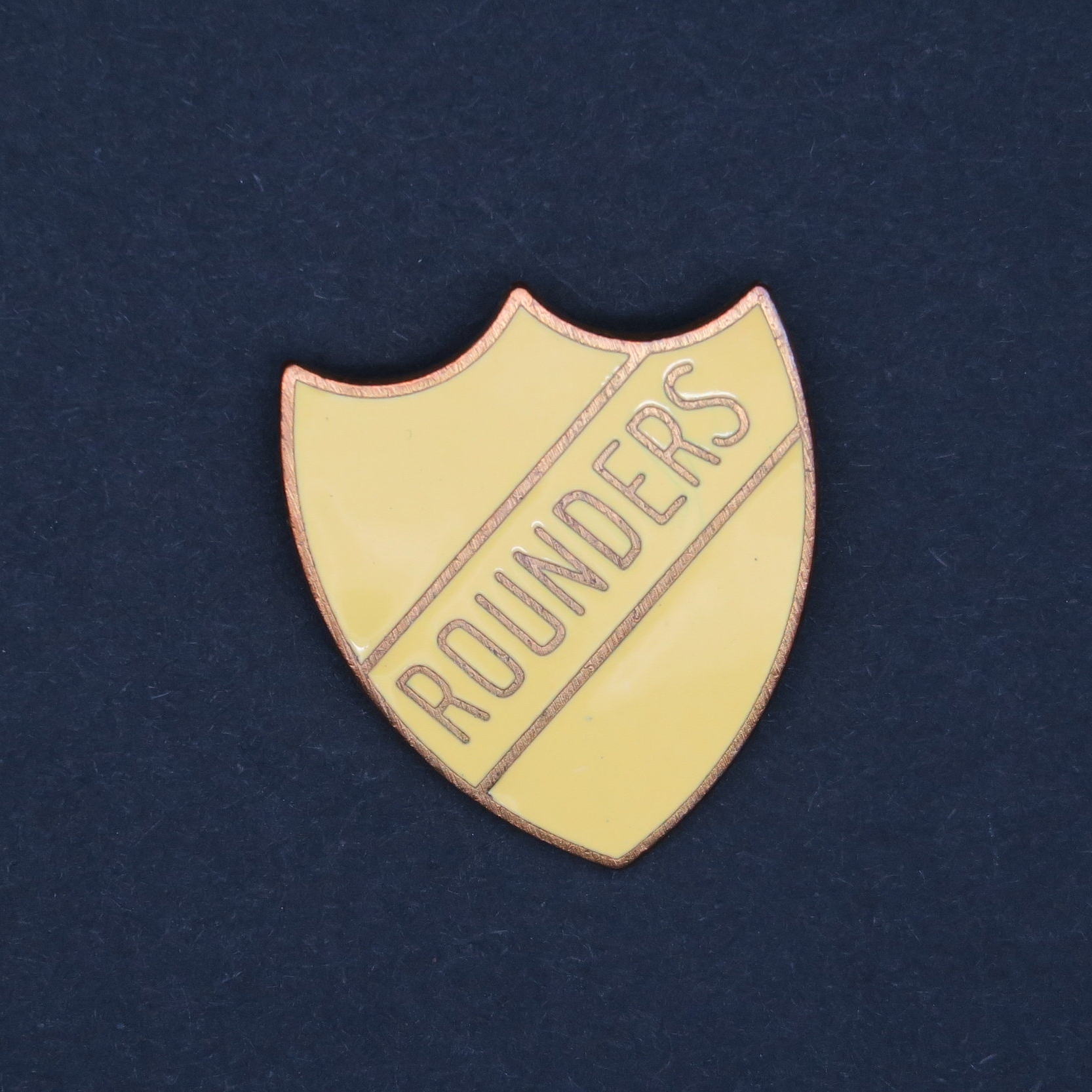 Like a 'prefect' badge, but better, because it says 'rounders'.