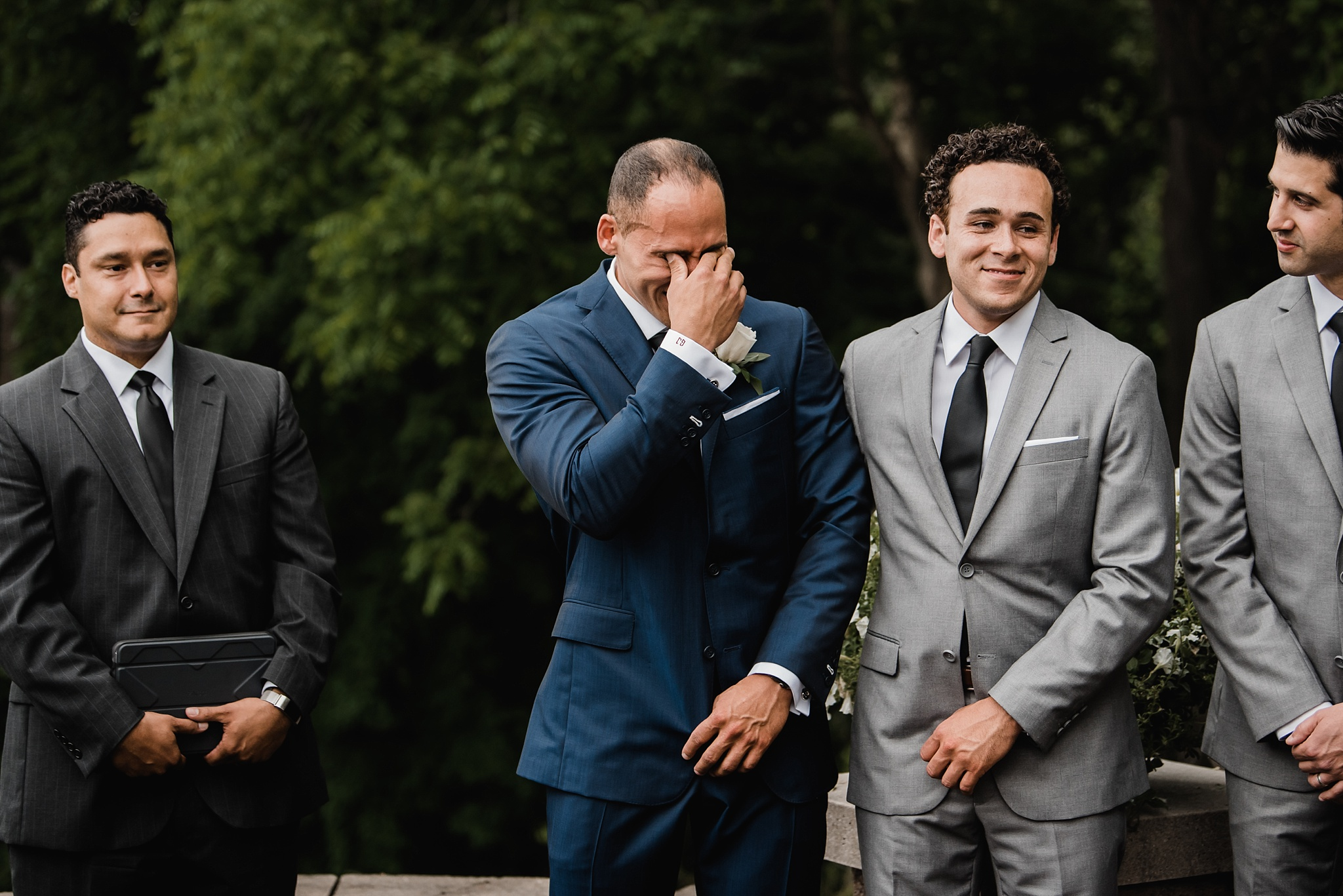 groom crying at alter