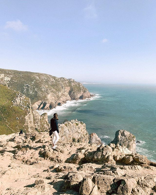 A little bit of soul searching at Cabo da Roca, the westernmost point of Europe ✨ It's funny thinking that geographically, I was literally the closest to home I've been since I left! ⠀⠀⠀⠀⠀⠀⠀⠀⠀ This Sunday, I'll arrive in Galicia on a bit of a soul searching adventure. My great-grandmother was from a little town called Lugo, and I'm hoping I can find her family's records. ⠀⠀⠀⠀⠀⠀⠀⠀⠀ For whatever reason, I've always been fascinated by my heritage and genealogy. Uncovering the past is an exciting puzzle. If I'm lucky, I'll get to meet distant relatives, but even if not, finding their tombstones in the cemetery or visiting the church they probably went to every week is meaningful enough. Although I never met her, seeing the hills, cobble stones and landscapes of her every day life helps me feel connected to the past. Places hold stories and emotion, even if they are invisible to us. ⠀⠀⠀⠀⠀⠀⠀⠀⠀ When we know where we have come from, there's a chance we might have a better idea of where we're going. . . . . #jenontherun #chasinglight #artofvisuals #exploretocreate #exploringtheglobe #letsgosomewhere #lifeofadventures #liveauthentic #neverstopexploring #passionpassport #seekmoments #seekadventure #seetheworld #welivetoexplore #tlpicks #tblogger #womenwhotravel #createcultivate #travelprenuer #livewhatyoulove #youbelong #cabodaroca #westernmostpoint #geneology #soulsearching #connectedtonature #portugal #visitportugal #ancestry
