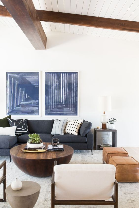 Hang up large art prints to fill up wall space and help complete the look of your room.