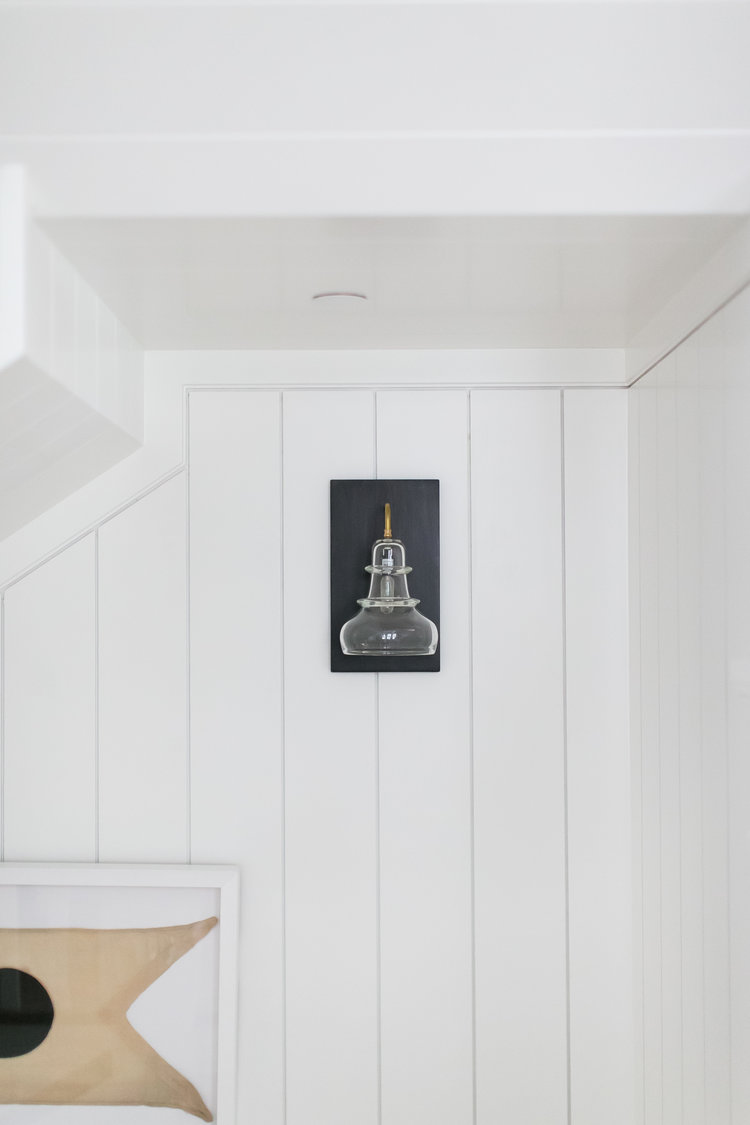 Focus on the details...add some paneling to your walls and thoughtfully place beautiful wall sconces.