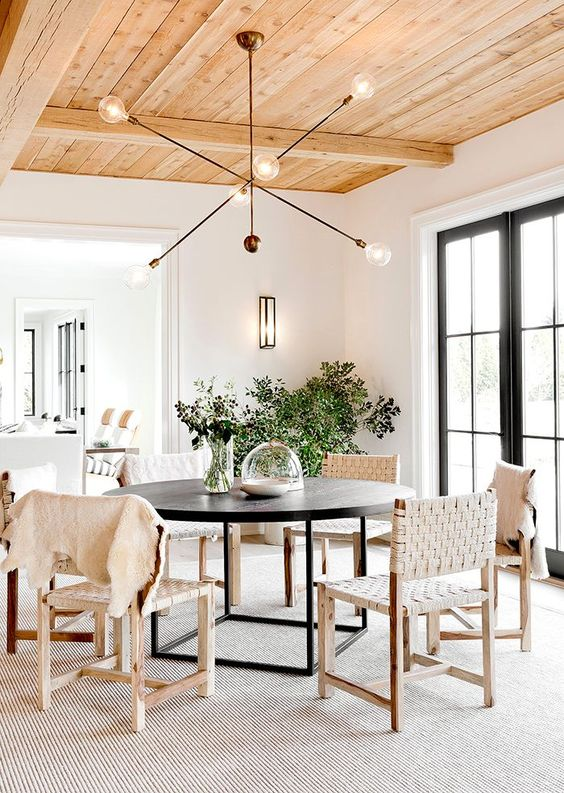Hang a large light fixture above your dining table to really make a statement.