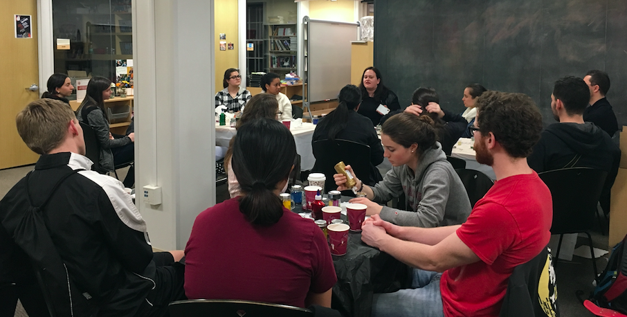 Students listen to Kramer-Lange's stories about patients she's interacted with who have used glitter jars before operations.
