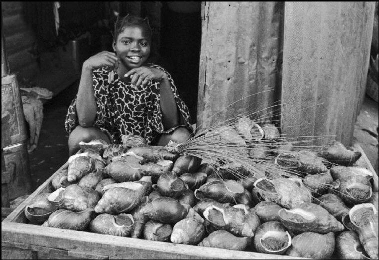 An Igbo woman at market in Onitsha, Nigeria, 1967. [Photo by Bruno Barbey]