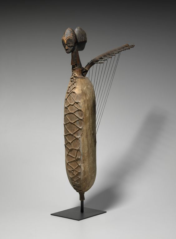 Fang harp with twin heads, early 20th century. Wood, hide, fiber. [From the Yale University Collection.]