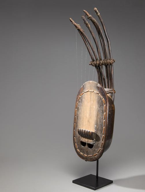Guitar from Cameroon. Wood, animal hide, metal and fiber.. Height: 29 1/2 in. (75 cm).