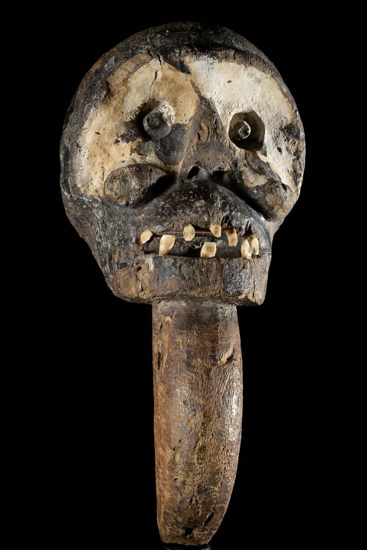 A monkey-head   scepter of the Bulu of Cameroon. Ca. 1950. Height: 12.5 in (32 cm).