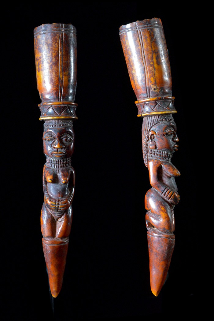 An  iroke  divination object used by Fa priests in voodoo rituals. Yoruba ethnic group of Nigeria. The Fa priest strikes a divination plate with the  iroke  while pronouncing incantations. He is rewarded by an oracle which predicts the future of the enquirer. Ivory. Height: 8 in (20 cm).
