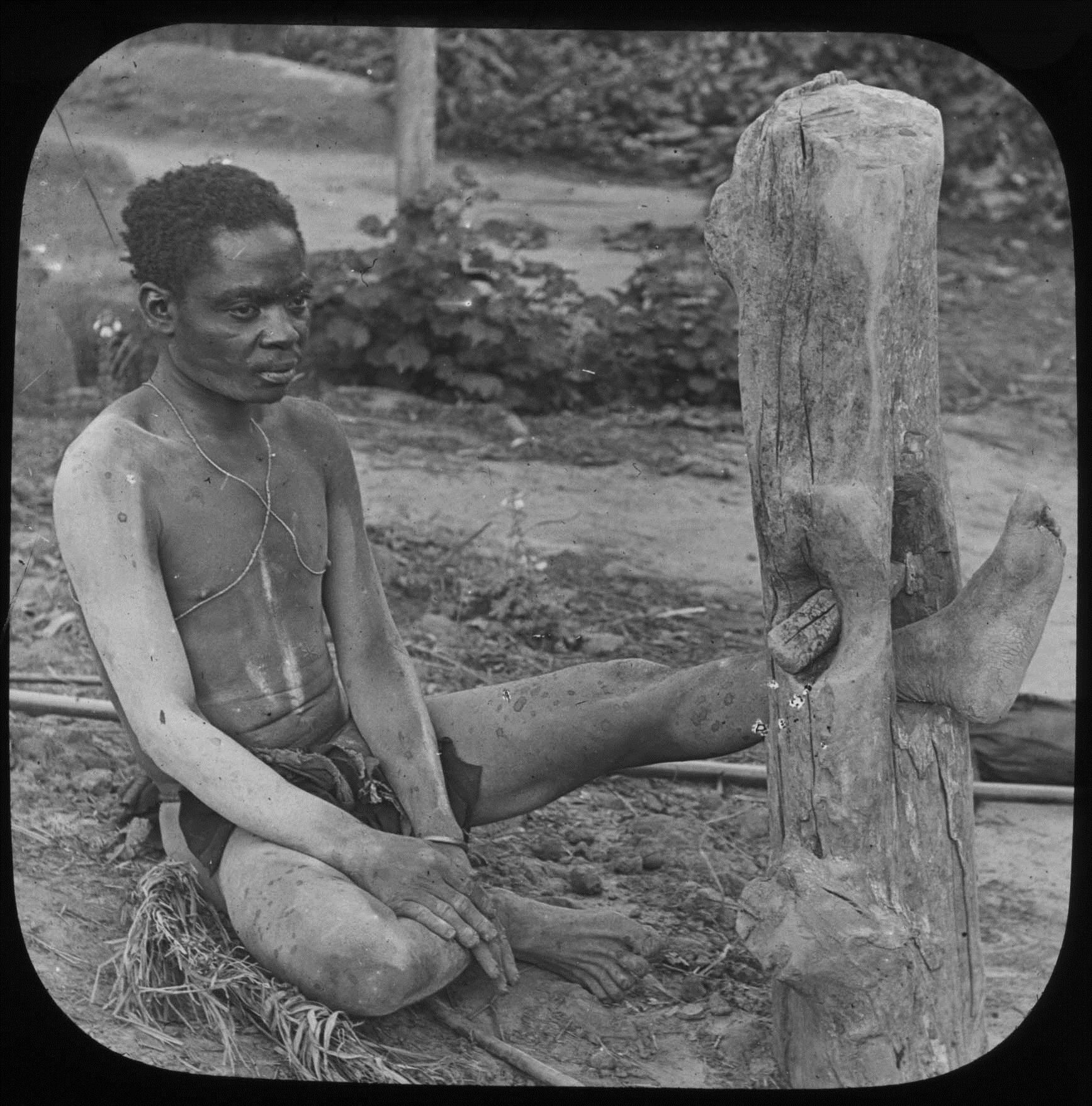 Above: an enslaved man. Photo by Joseph Burtt, sent to West Africa in 1905 by the Cadbury Company of England to investigate rumors that slaves were used to harvest cacao in the Portuguese colonies.