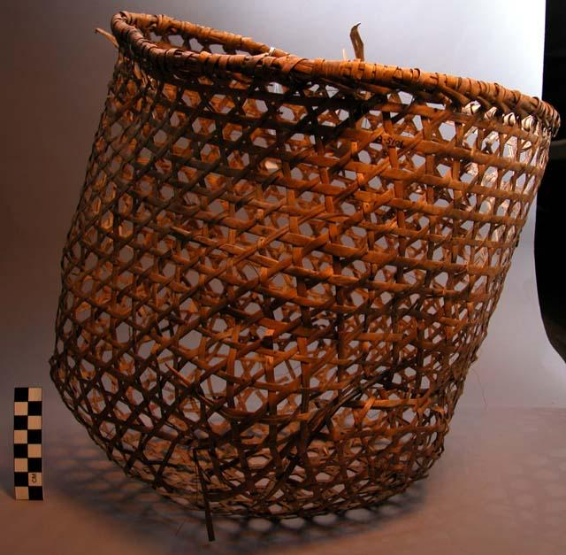 A Pygmy carrying basket made of split cane. Measurements: 31 x 32 x 24.5 cm (12 3/16 x 12 5/8 x 9 5/8 in.)