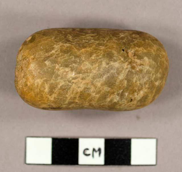 A hammerstone, battered at both ends, thought to be Lupemban culture, found in Angola. Lupemban culture was once thought to date from 10,000 to 12,000 BC but dates of 300,000 BC have been obtained from some sites.