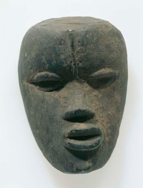 "A  ""Ziã ku Gli""  mask of Gbe clan of Liberia. This wooden mask seems made of stone."