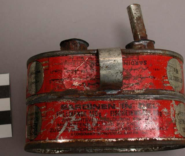 A kerosene lamp made from two sardine cans soldered together. Ewe tribe, Lomé, Togo.