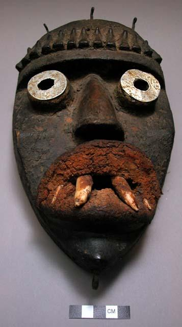 """A """"Zi"""" mask with animal teeth, from Ziali region of Liberia."""