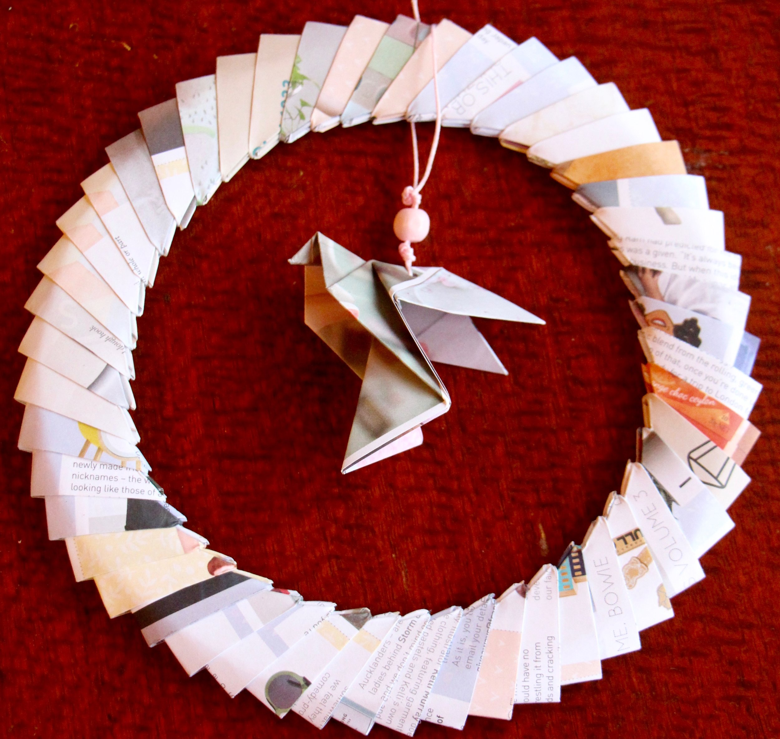 origami dove decoration wreath made using matte, thick, upcycled magazine paper (from Frankie magazine) ... beautiful pastel tones.