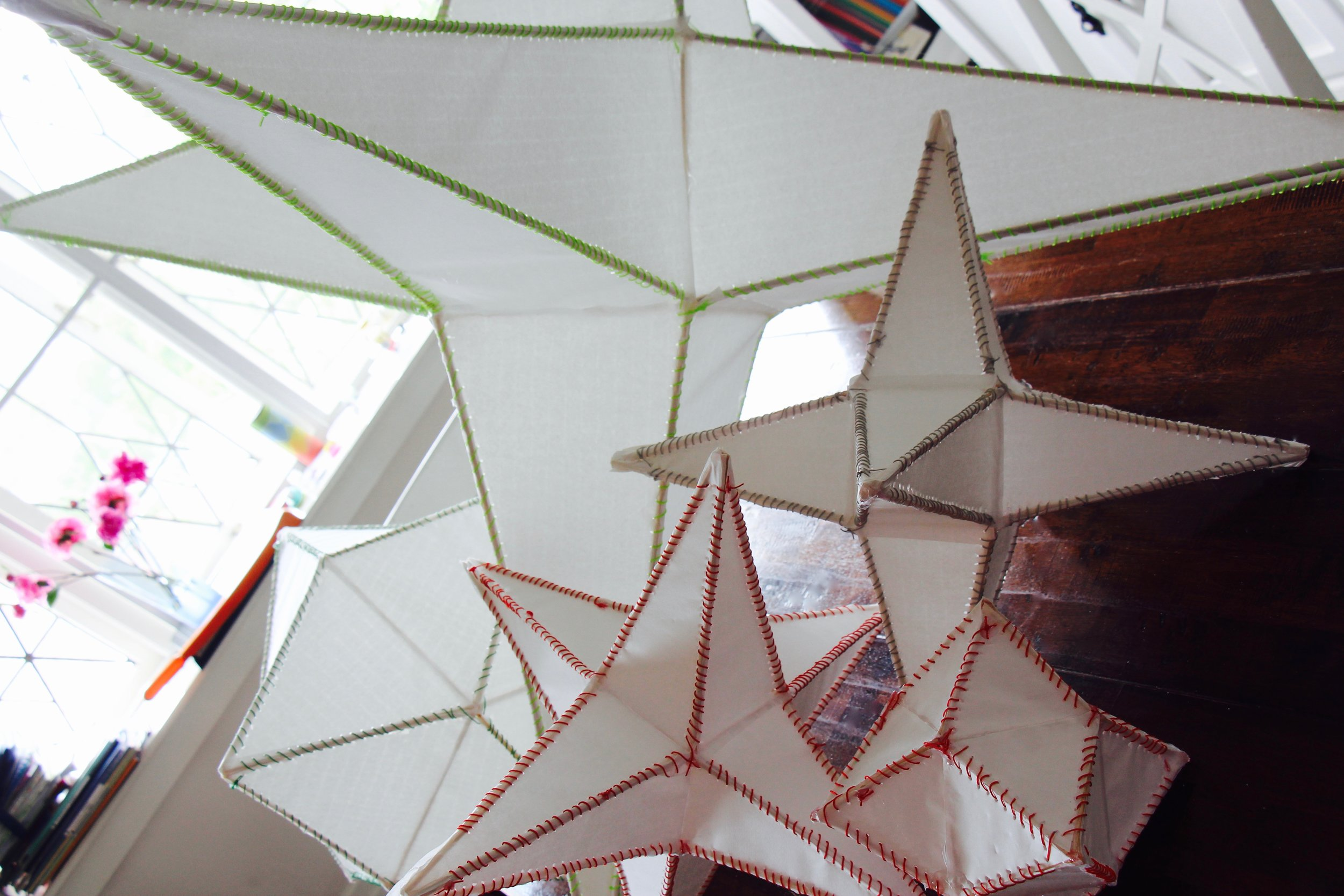 Star lanterns taking shape with colourful stitching ...