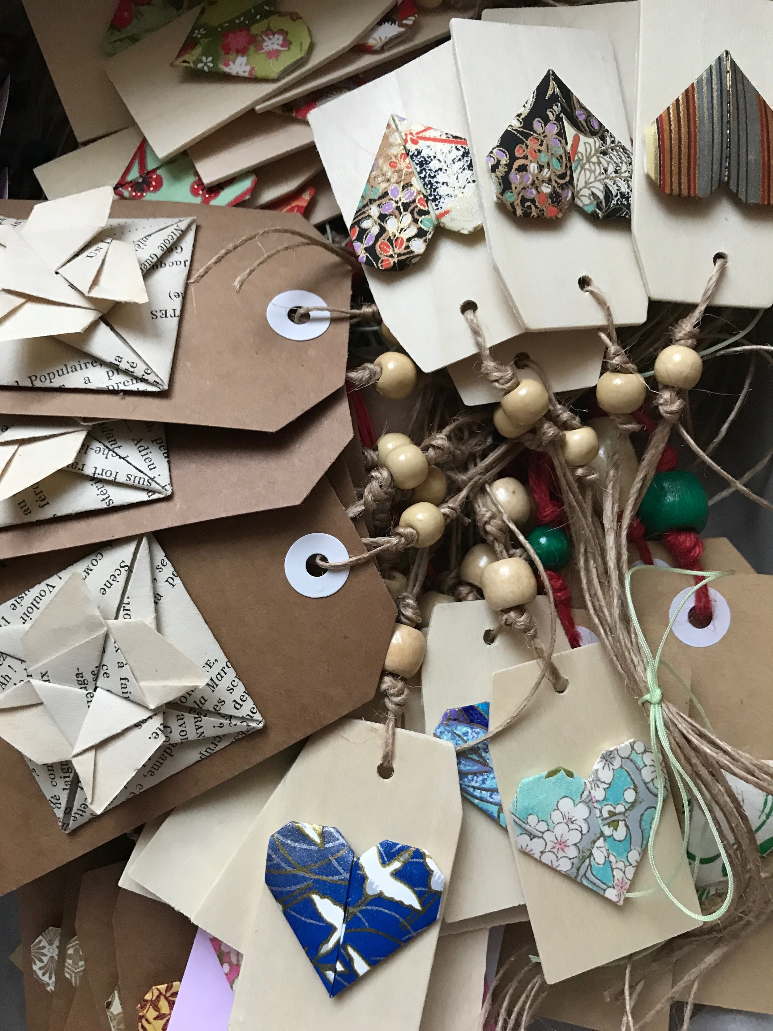 Beautiful gift cards incorporating origami elements and natural and upcycled materials.