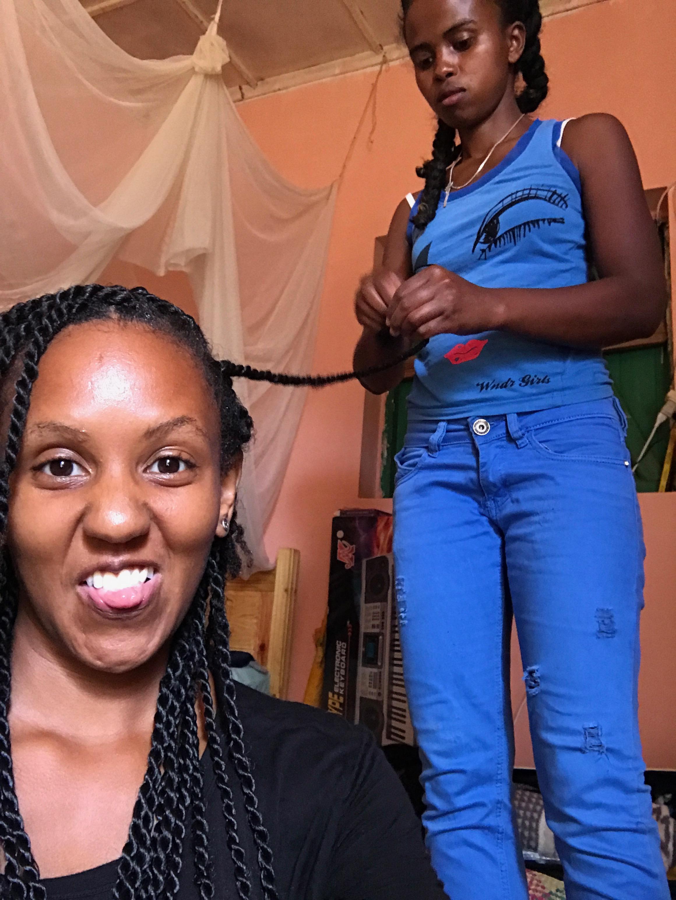 Tahina braiding my hair...