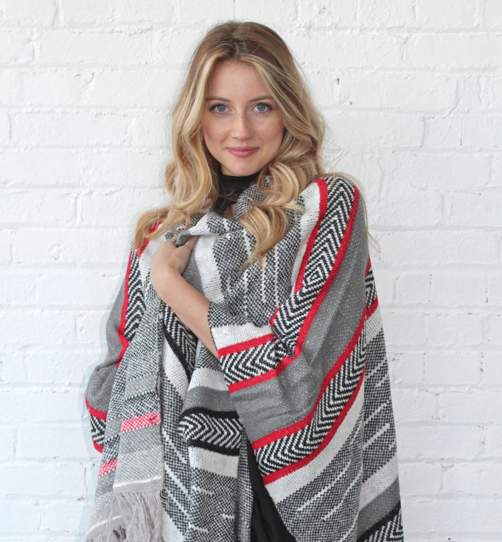 ELAN PONCHO - JOLIE OCCASIONSStyle it with the perfect suns, this Poncho from Jolie Occasions translates well from day to night.image: jolieoccasions.com