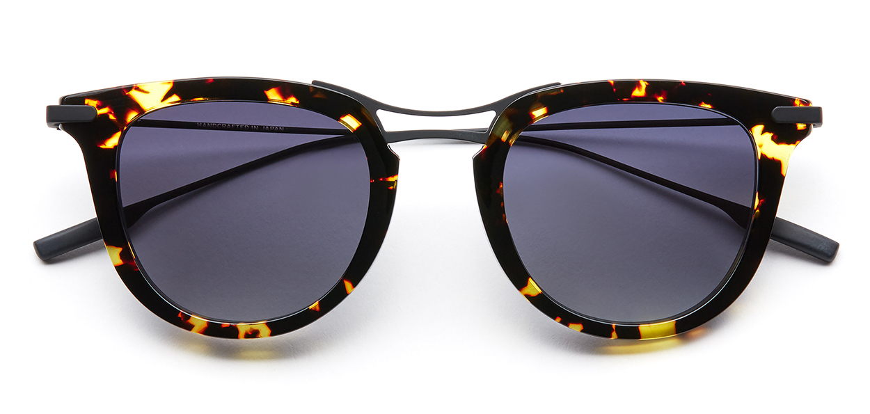 RAINES by SALT. - THE OPTICAL. COThe ultimate gift of luxury. Polarized gradient lenses crafted in a Japanese acetate / beta-titanium frame. Stunning in this yellow jacket | black sand color, Raines promises to be the favorite this holiday season.image: saltoptics.com
