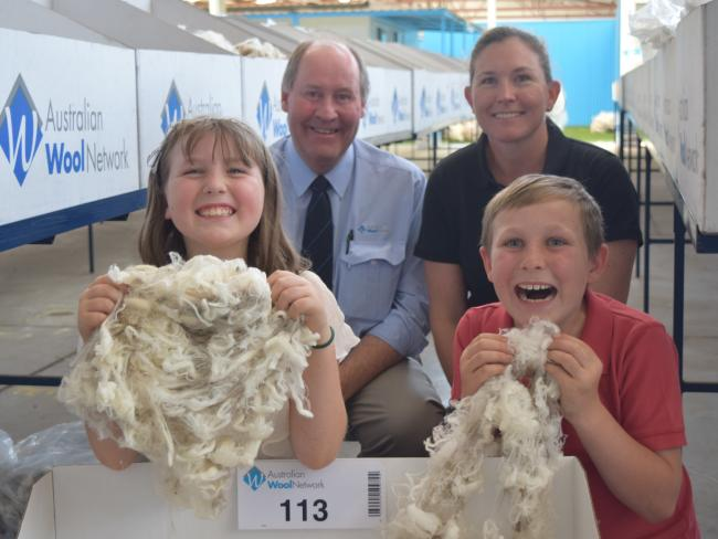 Happy days: Kirstie Anderson, from Avington Merino stud, with agent Ron Creek, Australian Wool Network, and children Georgie, 8, and Jack 10, at Melbourne, where the family offered superfine wool for sale. Picture: Jamie-Lee Oldfield