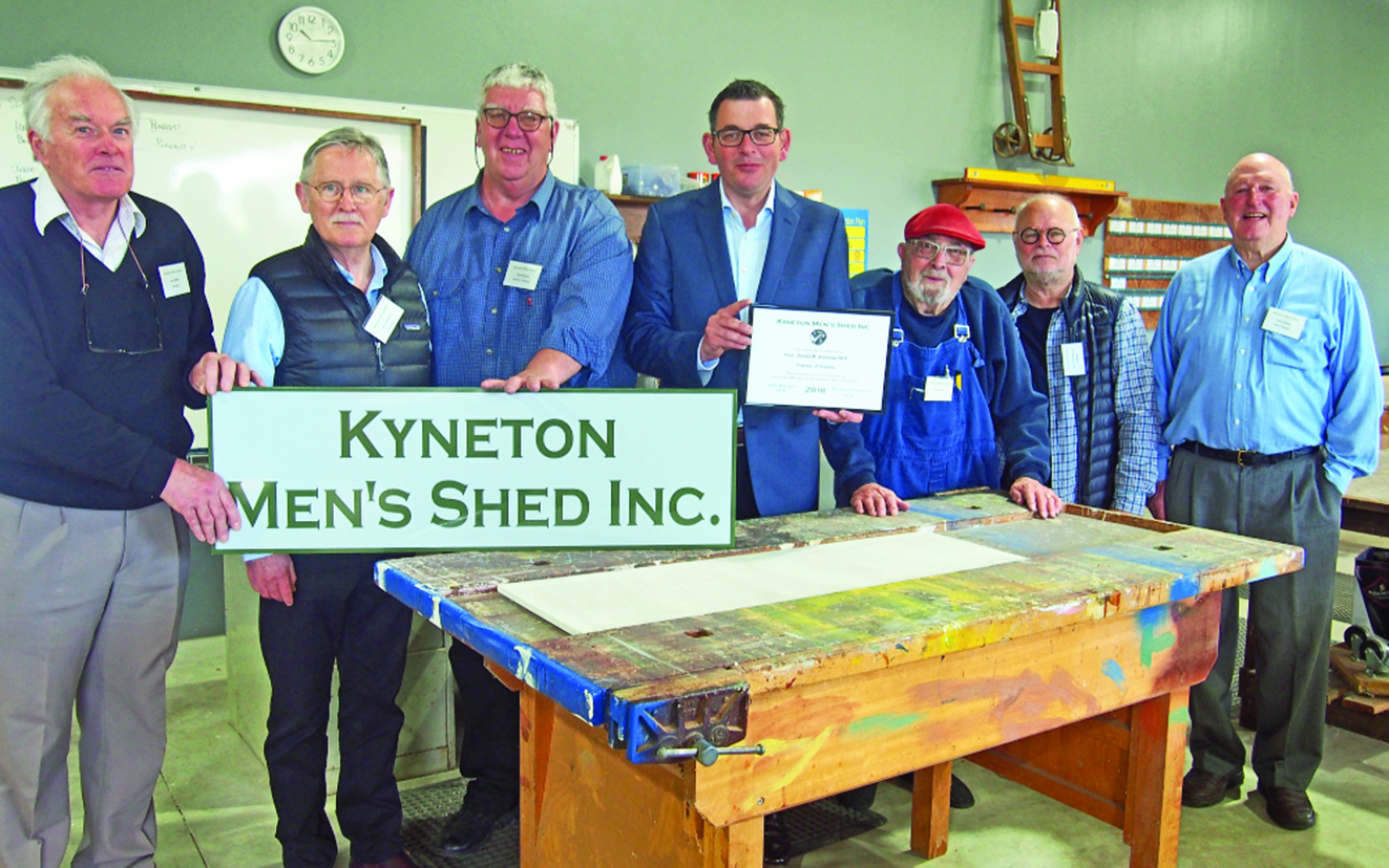 Noel Henderson supporting Kyneton's Men's Shed. Pictured with Premier Daniel Andrews and members of the Men's SHed