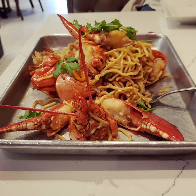 Lobster Garlic Noodles from EMC Seafood & Raw Bar at Santana Row in San Jose, CA  The lobster is cooked with white wine sauce and mixed with garlic noodles. It comes out really good. The lobster is also cracked for easy eating.  The restaurant itself seems to to be a mix between Chinese, Japanese, and American seafood altogether. It offers  variety of food from Japanese's sashimi and roll to Chinese style stir fried seafood to American cajun style or lobster roll. If you cannot decide which kind of seafood you want to eat, this will be a very good choice.  Alexi.xyz verdict: it's a good one and I'll come back here.  #Food #FoodInBayArea #Seafood #Lobster #GarlicNoodles #LobsterGarlicNoodles #AlexiXyz #AlexiXyzFood