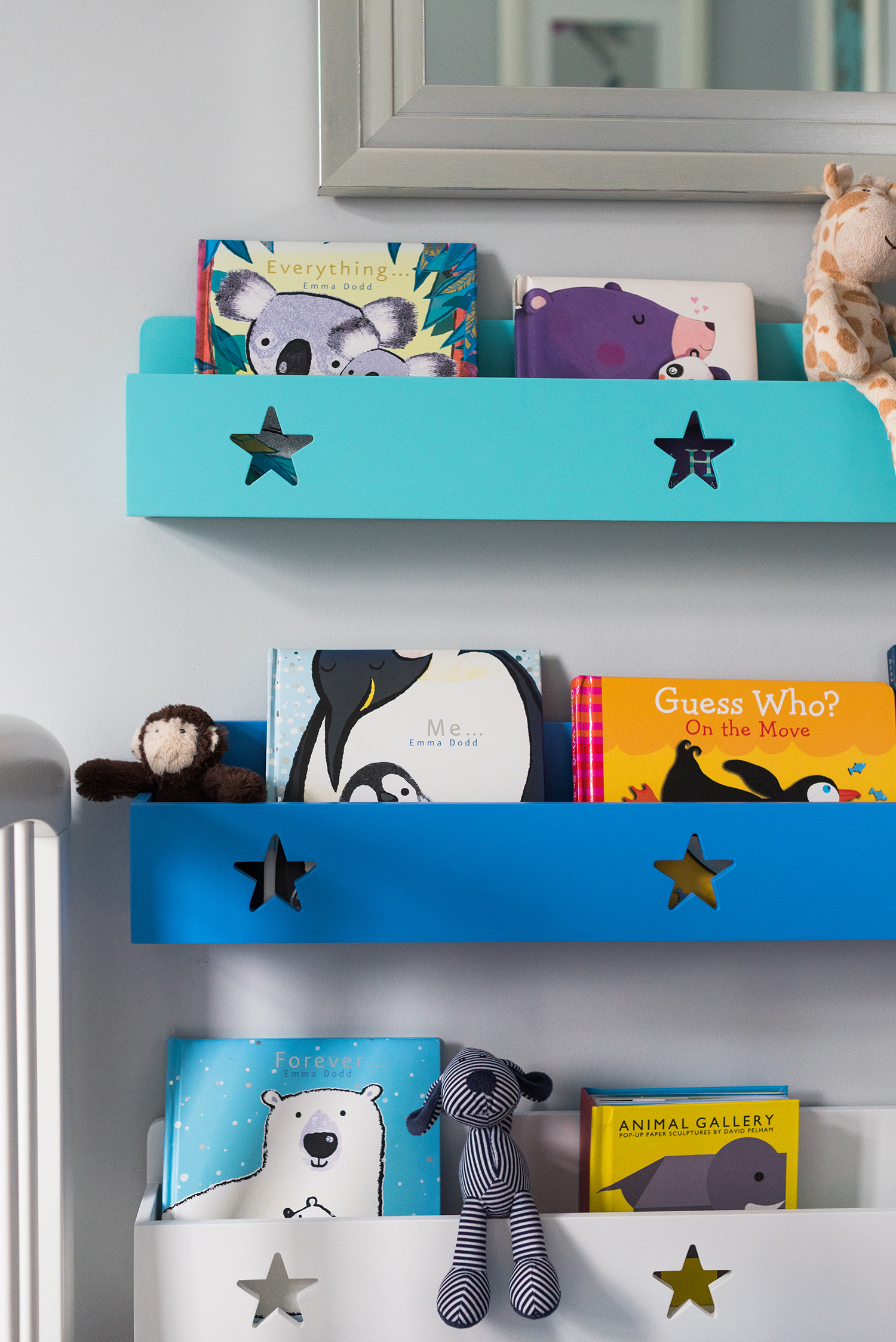 Close up view of bookshelf in peacock coloured unisex nursery
