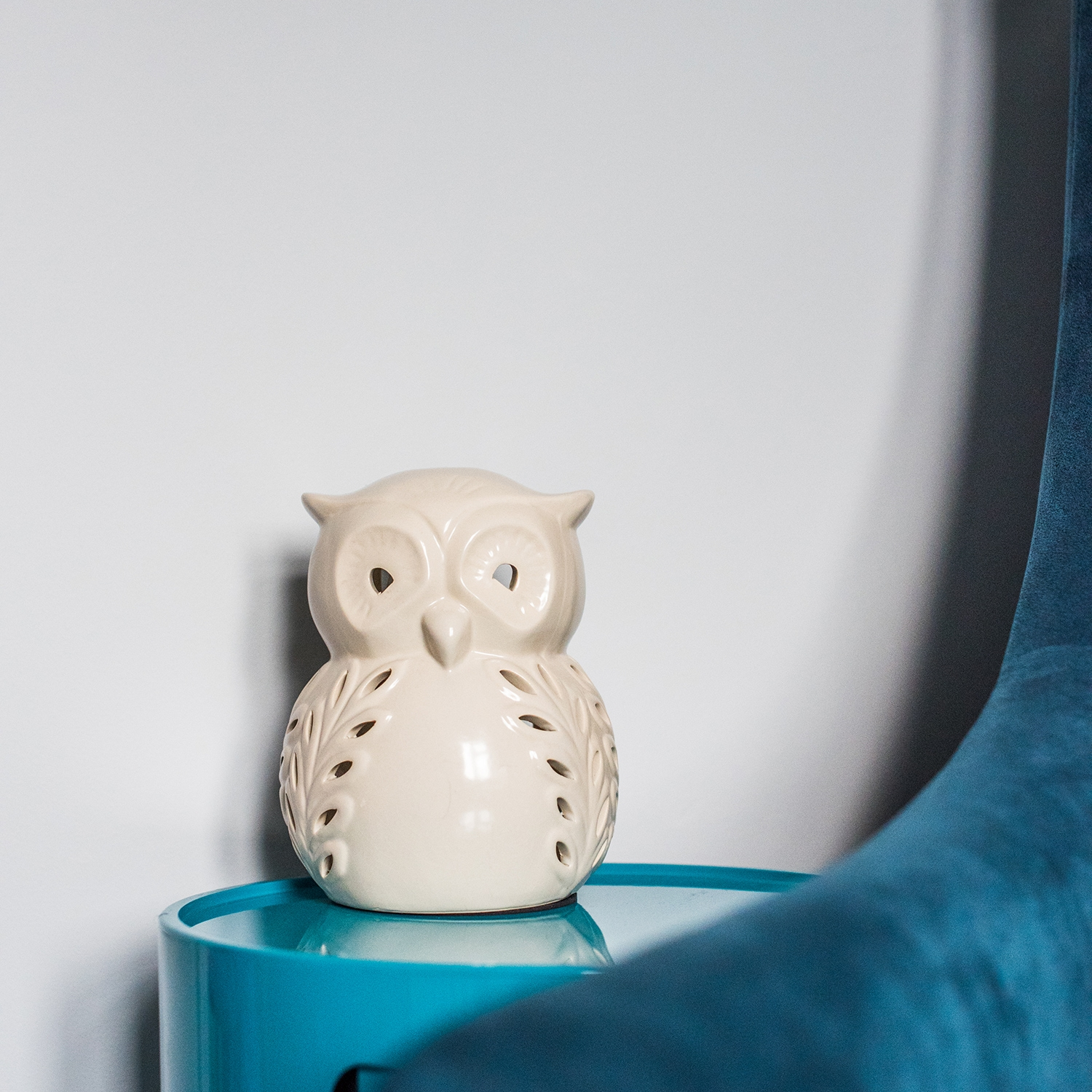 Close up view of owl light in peacock coloured unisex nursery