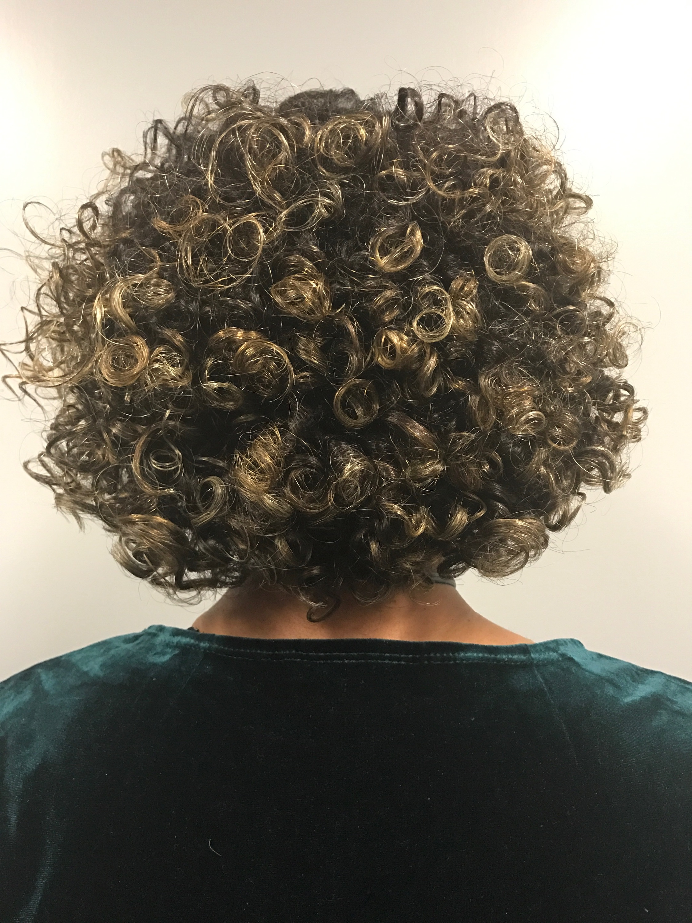 During my time with Rimmy she cut off my heat damage ends, shaped my curls and styled my hair.