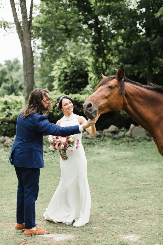 bride, groom and a horse