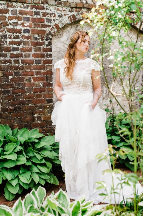 Bride dreaming in her garden before her ceremony