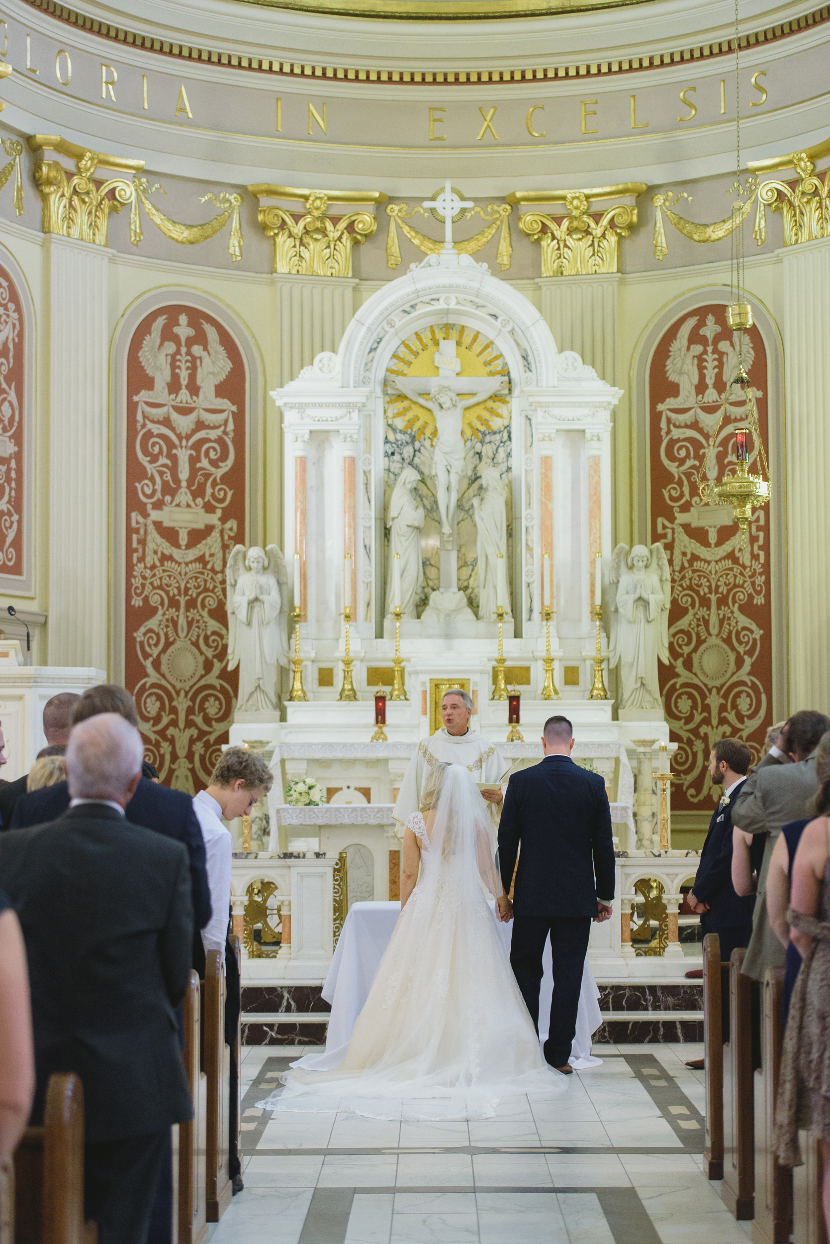 Bride and groom at the altar - Pearl Weddings and Events