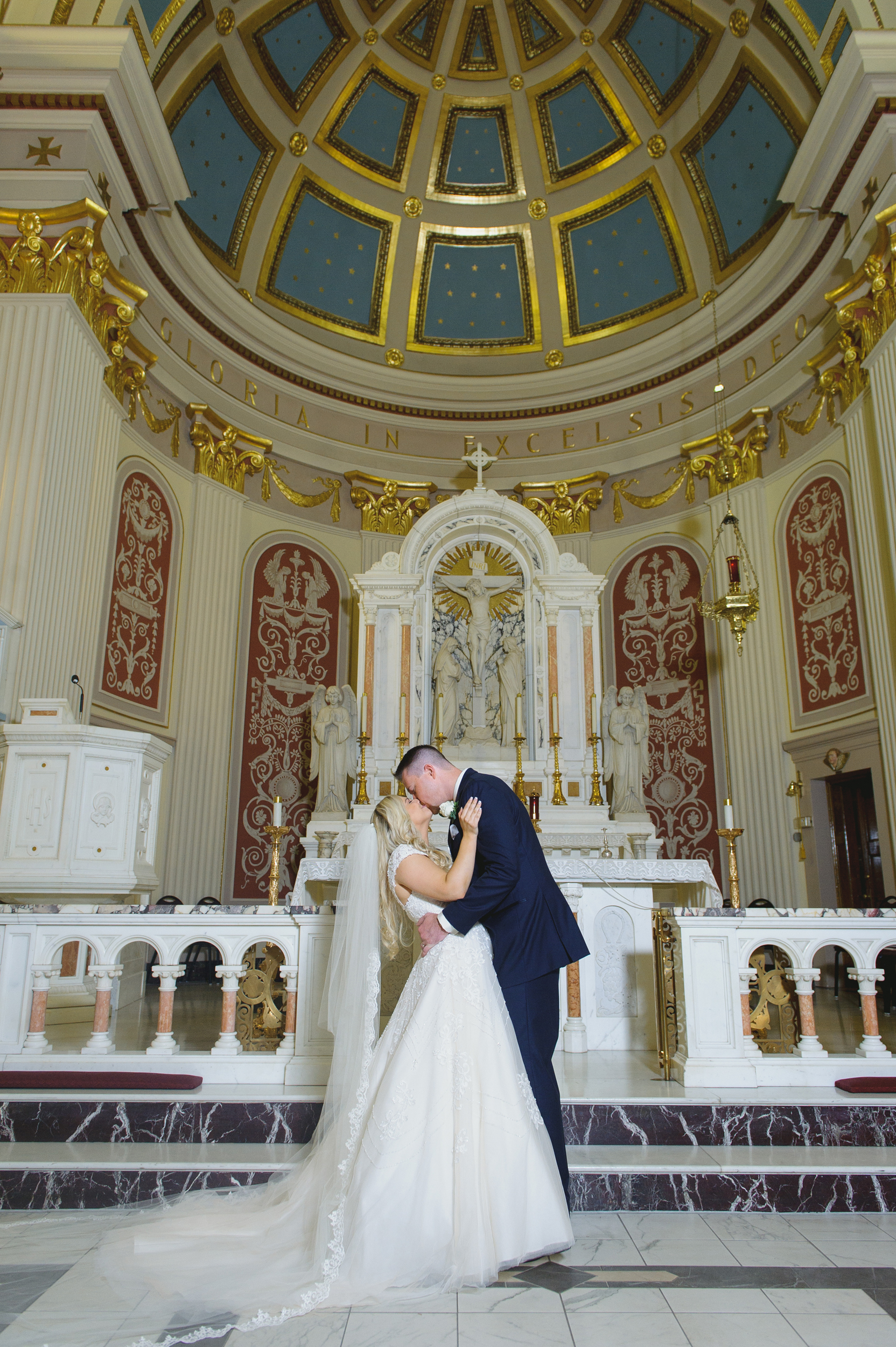 Groom kisses the bride - Pearl Weddings and Events