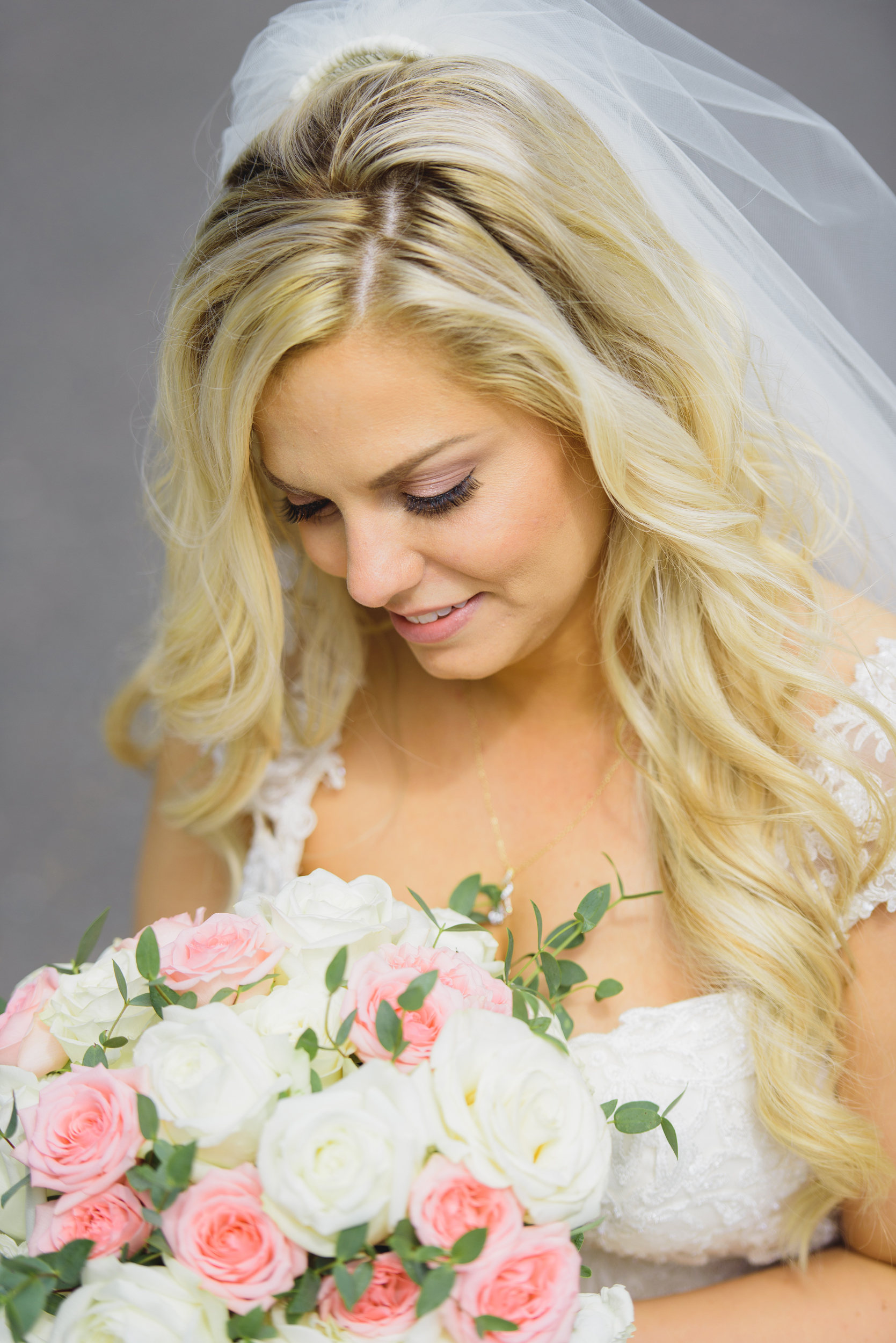 Bride and her flowers - Pearl Weddings & Events