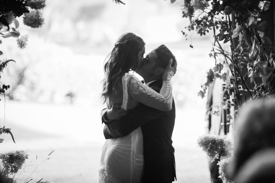 This is love at your ceremony. The first kiss! Planner | Pearl Weddings & Events