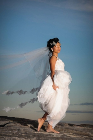 Barefoot bride on the beach at sunset - Pearl Weddings & Events