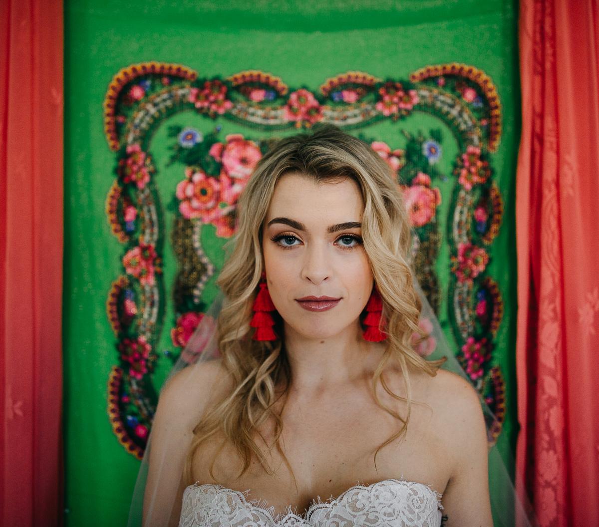 Beautiful bride with a fun backdrop!